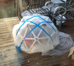 Covered geodesic dome greenhouse